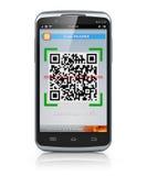 Smartphone scanning QR code Stock Images