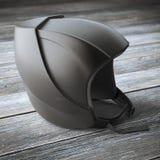 Modern black helmet on wooden table Stock Image