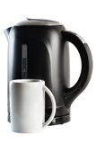 Modern black kettle and white cup isolated Stock Images