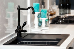 Modern black kitchen sink and faucet. In room interior royalty free stock image