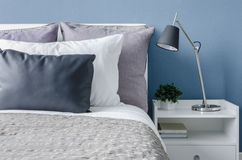 Modern black lamp on white table in modern bedroom Stock Photo