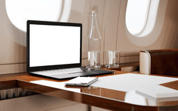 Modern Black Laptop Blank Screen Wood Table Inside Interior Luxury Private Airplane Jet.Empty Cabin Window Generic Stock Photo