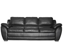 Modern black leather sofa Royalty Free Stock Photography