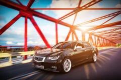 Modern black metallic sedan car on the bridge road. Generic desing, brandless. 3D rendering Stock Photos