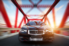Modern black metallic sedan car on the bridge road. Generic desing, brandless. Royalty Free Stock Image