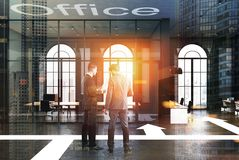 Modern black office, arrows on floor, men Stock Photography