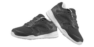 Modern black sports shoes royalty free stock image