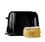 Modern black toaster with fresh bread Stock Photos