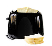 Modern black toaster with fresh bread Stock Photography