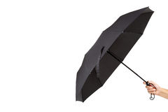 Modern black umbrella in hand on white background Stock Photography