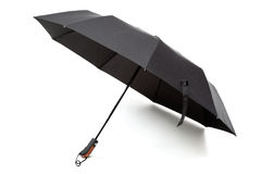 Modern black umbrella in the unfolded form. Stock Photo