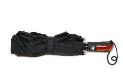 Modern black umbrella on white background. Stock Photos