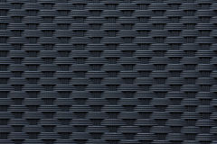 Modern black weave texture. Modern and contemporary plastic weave fabric pattern or texture suitable for backgrounds or website wallpaper Stock Photography