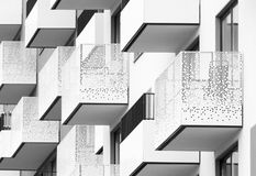 Modern black and white architectural abstract with balconies and. Modern architectural abstract with balconies and windows, black and white residential building royalty free stock photography