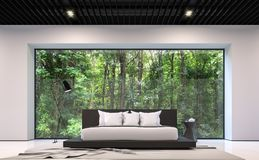 Modern black and white bedroom with forest view 3d rendering image. There are large window overlooking the surrounding garden and nature Royalty Free Stock Images