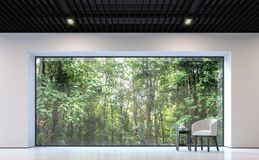 Modern black and white living room  with forest view 3d rendering image. There are white floor and wall,black steel ceiling.There are large window overlooking Stock Photos
