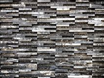 Modern black and white rock wall near the street. Modern black and white rock wall near the street, picture Royalty Free Stock Photography