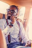 Modern blackman i en blå skjorta royaltyfri foto