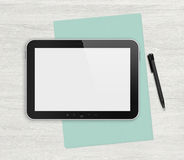 Blank digital tablet on a white desk. Modern blank digital tablet, papers and pen on a blank wooden desk. Top view. High quality detailed graphic collage Royalty Free Stock Images