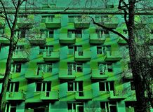 An original modern blue and yellow block of flats in the centre of Cracow, Poland royalty free stock photos