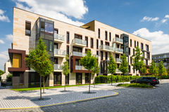 Modern block of flats in suburban area Royalty Free Stock Photography