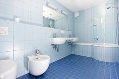 Modern blue bathroom Stock Image