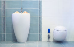 Modern blue  bathroom. With sink and toilette Royalty Free Stock Photo