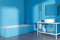 Modern blue bathroom corner, minimalism. Blue tiled bathroom corner with a long sink and a loft window. A concrete floor. A cozy home concept 3d rendering mock Royalty Free Stock Photo