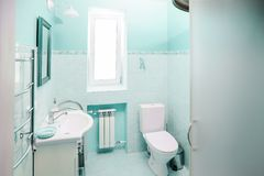 Modern blue bathroom. Modern sink in a new bathroom in blue tones Stock Images