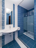 Modern blue bathroom. Modern bathroom toled with white and blue tiles Stock Photography