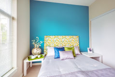 Modern blue bedroom interior design. Modern blue bedroom interior with blue,  green, and violet designer pillows in a luxury house. Interior design Stock Photo