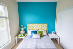 Modern blue bedroom interior. With blue, green, and violet designer pillows in a luxury house Stock Photo