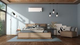 Modern blue and brown master bedroom Stock Photography