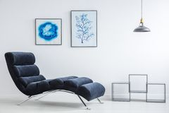 Modern blue couch. And contemporary art on the wall Stock Images