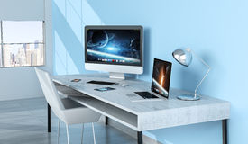 Modern blue desktop interior with devices 3D rendering Royalty Free Stock Photography