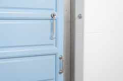Modern blue door and handle in home. Close up modern blue door and handle in home royalty free stock image