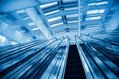 Modern blue escalator Stock Photo