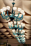 Modern blue  glass chandelier for hotel interior Royalty Free Stock Photo