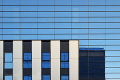 Modern blue glass facade of an office skyscraper. Abstract architecture background. Empty copy space for Editor`s text Royalty Free Stock Photography