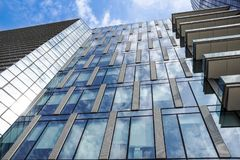 Modern blue glass wall of office building.  Royalty Free Stock Images