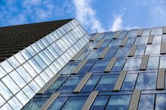 Modern blue glass wall of office building.  Stock Photos