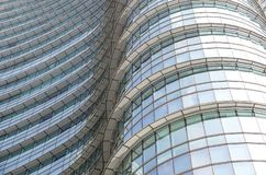 Modern blue glass wall of office building.  Stock Photo