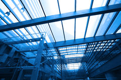 Modern blue glass wall of office building. Image of  in morden office building Stock Images