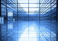 Modern blue glass wall of office building. Image of windows in morden office building Royalty Free Stock Photos
