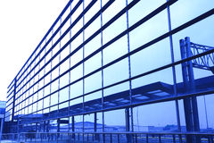 Modern blue glass wall of office building. Image of windows in morden office building Stock Photography