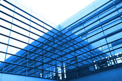 Modern blue glass wall of office building. Image of windows in morden office building Stock Images