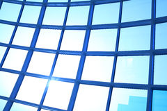 Modern blue glass wall of office building. Image of windows in morden office building Royalty Free Stock Photo