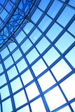 Modern blue glass wall of office building. Image of windows in morden office building Royalty Free Stock Images