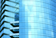 Modern blue glass wall of skyscraper. In city Royalty Free Stock Photos