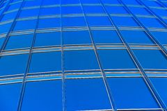 Modern blue glass wall of skyscraper Royalty Free Stock Images